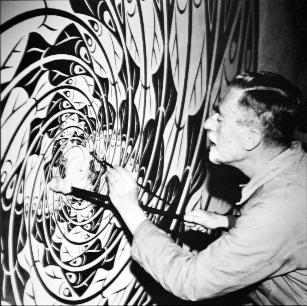 Escher at work on Sphere Surface with Fish in his workshop, late 1950s, Pedro Ribeiro Simões, CC BY 2.0.